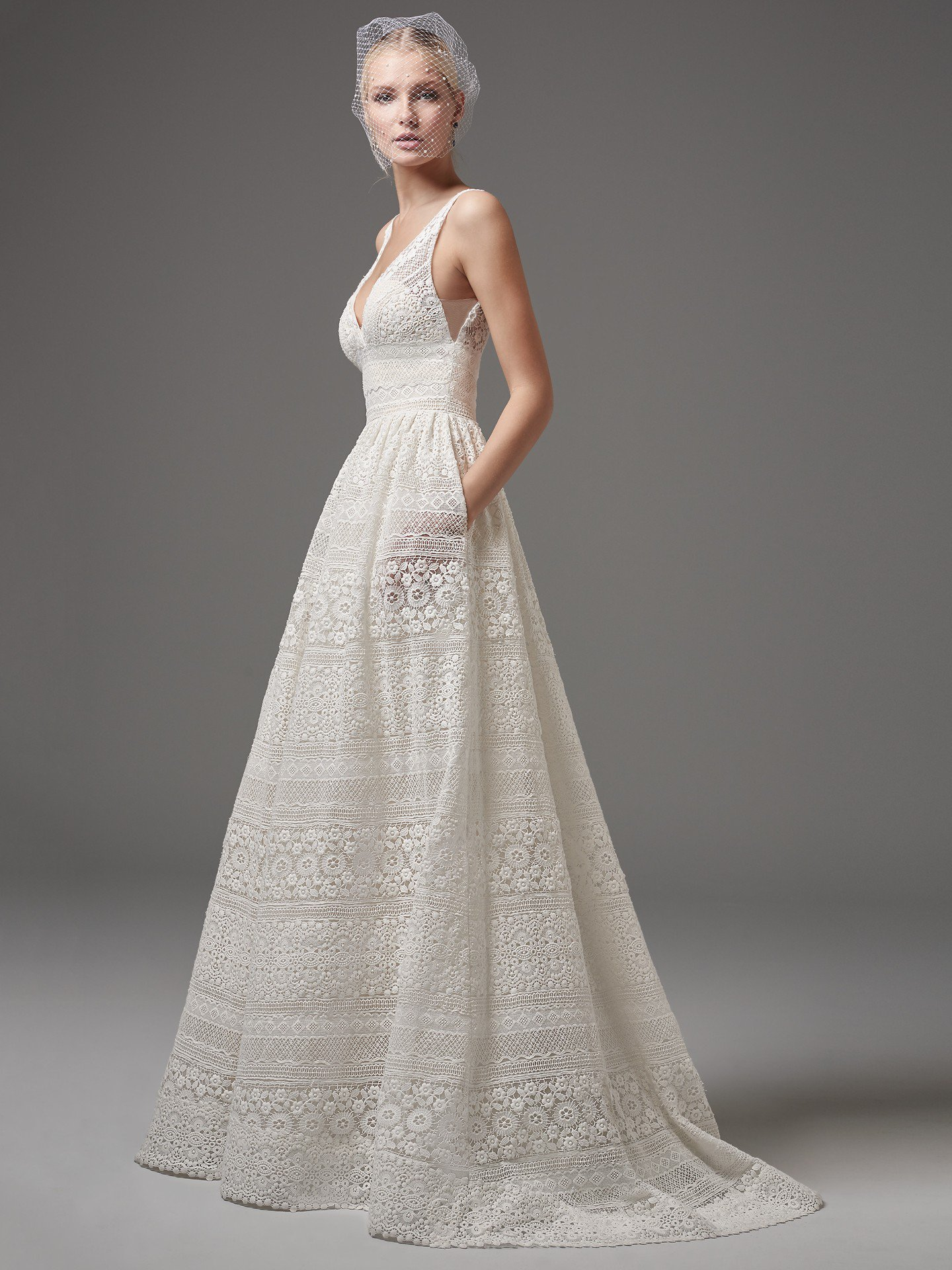 EVAN This chic, boho-inspired A-line features sheer pockets and patterns of eyelet lace, floral motifs, and scalloping. Sheer lace straps complete the V-neckline and sexy square-back. Finished with zipper closure. Detachable tulle overskirt with lace waistband sold separately.